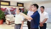 长沙市委常委、统战部长谭小平一行考察土流集团